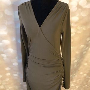 Fitted olive dress with rush detail at the hip